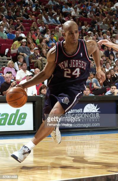 Richard Jefferson of the New Jersey Nets moves the ball during the game with the Orlando Magic at TD Waterhouse Centre on January 8 2005 in Orlando...
