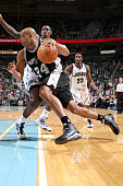 Richard Jefferson of the San Antonio Spurs drives to the basket around Ronnie Brewer at EnergySolutions Arena on December 7 2009 in Salt Lake City...