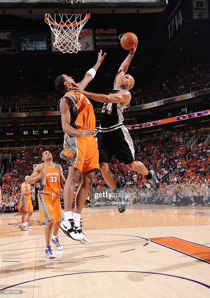 Richard Jefferson #24 of the San Antonio Spurs dunks against Channing Frye #8 of the Phoenix Suns in Game Two of the Western Conference Semifinals during the 2010 NBA Playoffs at the U.S. Airways Center on May 5, 2010 in Phoenix, Arizona. The Suns are wearing their 'Los Suns' jerseys on Cinco de Mayo in response to an anti-immigration law recently passed in Arizona.