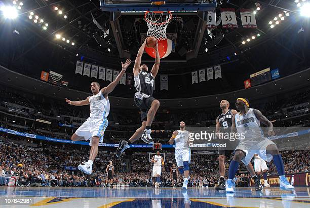 Richard Jefferson of the San Antonio Spurs goes to the basket against Aaron Afflalo of the Denver Nuggets on December 16 2010 at the Pepsi Center in...