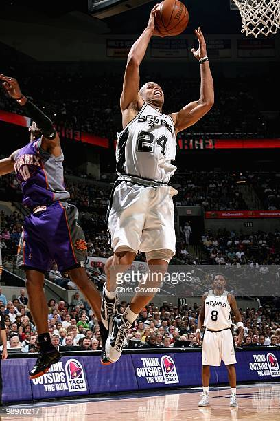 Richard Jefferson of the San Antonio Spurs goes to the basket past Leandro Barbosa of the Phoenix Suns in Game Four of the Western Conference...
