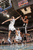 Richard Jefferson of the San Antonio Spurs goes up for the shoot against Andrei Kirilenko of the Utah Jazz at EnergySolutions Arena on November 5...