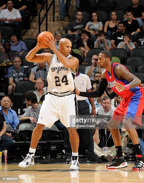 Richard Jefferson of the San Antonio Spurs looks to pass against Rasual Butler of the Los Angeles Clippers on October 14 2009 at the ATT Center in...
