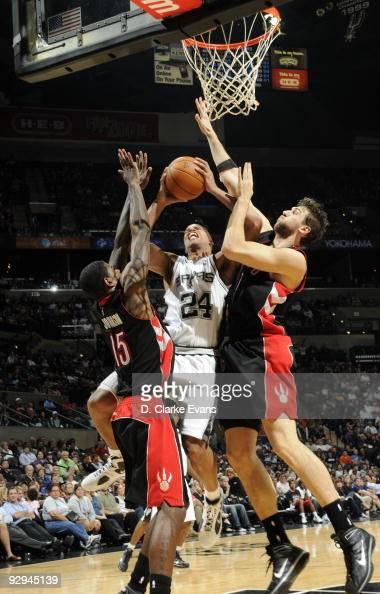 Richard Jefferson of the San Antonio Spurs shoots between Jose Calderson and Amir Johnson of the Toronto Raptors on November 9 2009 at the ATT Center...