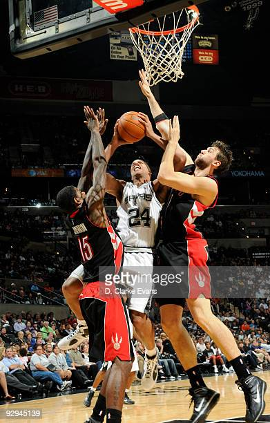 Richard Jefferson of the San Antonio Spurs shoots between Jose Calderson and Amir Johnson of the Toronto Raptors on November 9 2009 at the ATT Center...