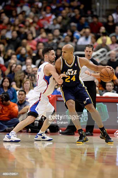 Richard Jefferson of the Utah Jazz handles the basketball against JJ Redick of the Los Angeles Clippers at STAPLES Center on February 1 2014 in Los...