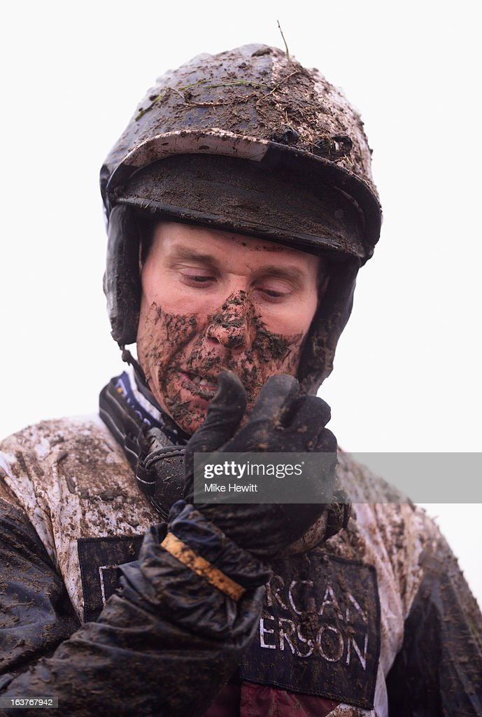 Richard Johnson comes back mud spattered after the Vincent O'Brien County Handicap Hurdle at Cheltenham Racecourse on March 15, 2013 in Cheltenham, England.