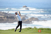 Richard Johnson hits a tee shot on the fourth hole during the first round of the ATT Pebble Beach National ProAm at Spyglass Hill on February 12 2015...