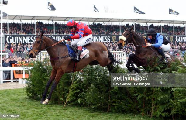 Richard Johnson on Balthazar King clears the final hurdle to win the Glenfarclas Handicap Steeple Chase during day one of the 2012 Cheltenham...