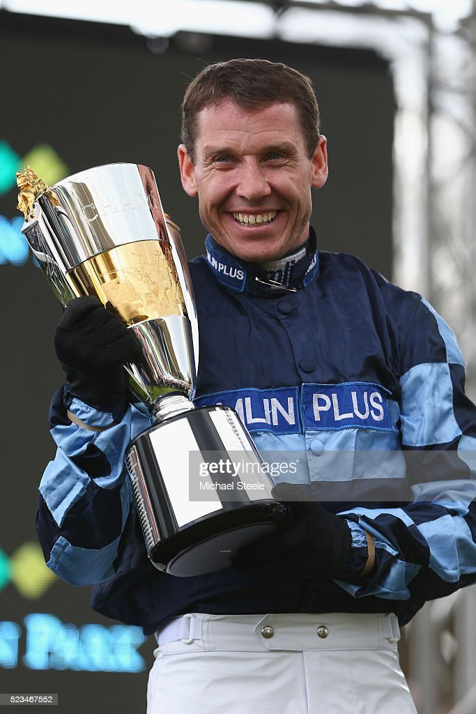 Richard Johnson receives the champion jockey trophy at Sandown Park on April 23, 2016 in Esher, England.