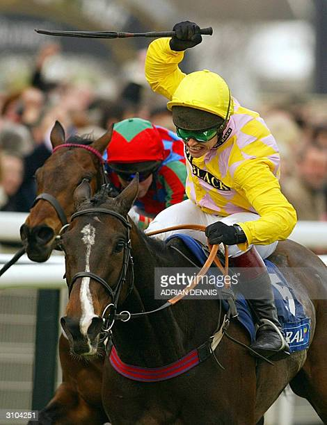 Richard Johnson rides Monkerhostin up the final straight to win The Coral Cup Handicap Hurdle Race at The Cheltenham Horse Racing Festival 17 March...