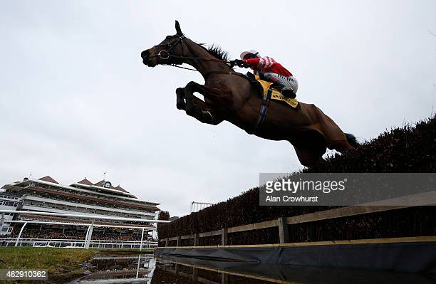 Richard Johnson riding Coneygree clear the water jump before winning The Betfair Denman Steeple Chase at Newbury racecourse on February 07 2015 in...