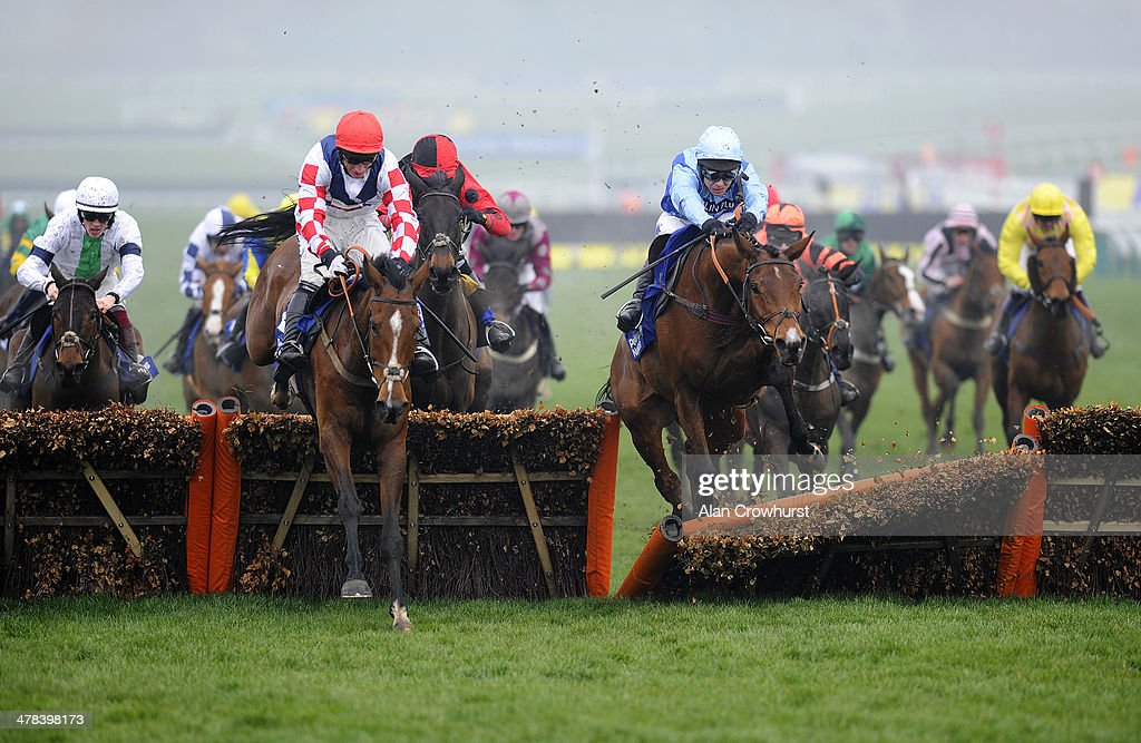 Richard Johnson riding Fingal Bay (C) smash through the last to win The Pertemps Newtwork Final on St Patrick's Thursday during the Cheltenham Festival at Cheltenham racecourse on March 13, 2014 in Cheltenham, England.