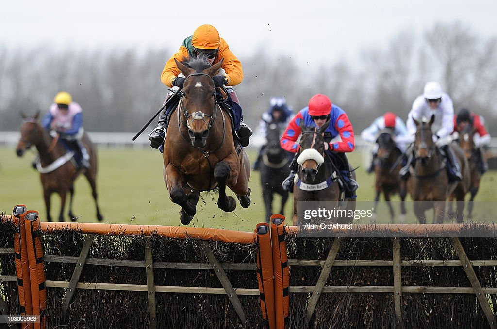 Richard Johnson riding Lord Grantham leap the last to win The Molly Morton Celebration Handicap Hurdle Race at Huntingdon racecourse on March 03, 2013 in Huntingdon, England.