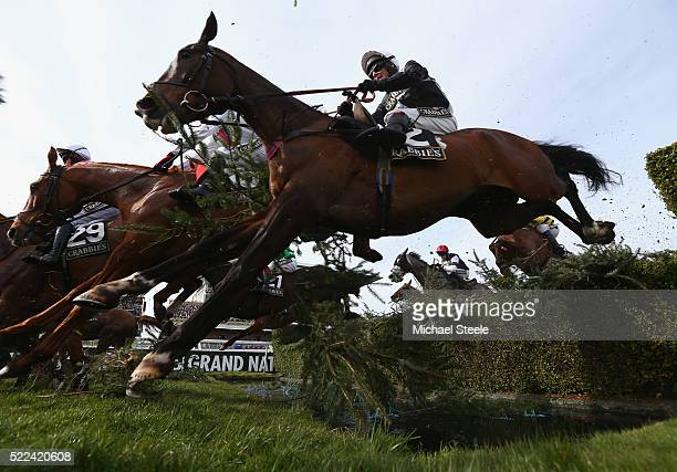 Richard Johnson riding Village Vic clears the water jump in the Crabbie's Topham Steeple Chase on April 8th 2016 at AintreeEngland With over 3000...