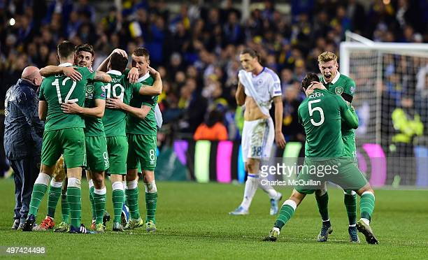 Richard Keogh and James McClean of Republic of Ireland embrace as they celebrate after the Euro 2016 playoff second leg match between the Republic of...