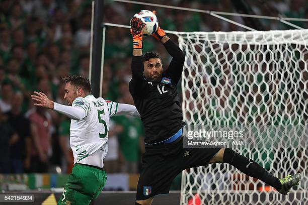 Richard Keogh of Ireland is beaten to the ball by Salvatore Sirigu of Italy during the UEFA EURO 2016 Group E match between Italy and Republic of...