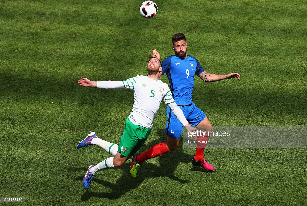 Richard Keogh of Republic of Ireland and Olivier Giroud of France compete for the ball during the UEFA EURO 2016 round of 16 match between France and Republic of Ireland at Stade des Lumieres on June 26, 2016 in Lyon, France.