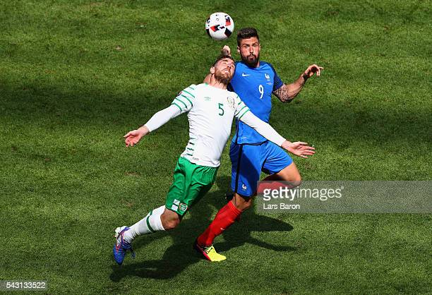 Richard Keogh of Republic of Ireland and Olivier Giroud of France compete for the ball during the UEFA EURO 2016 round of 16 match between France and...