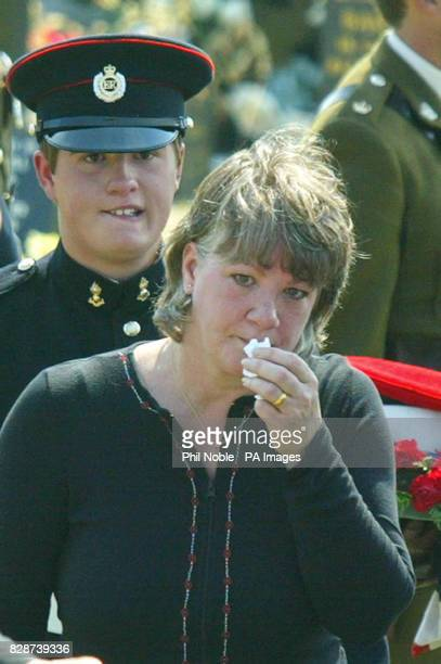 Richard Keys the brother of Lance Corporal Thomas Keys with his mother Sally leave St John's Church in Barmouth after the funeral service for Lance...