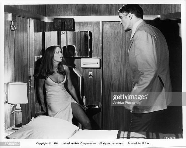 Richard Kiel backing actress Barbara Bach into a corner in a scene from the film 'The Spy Who Loved Me' 1977