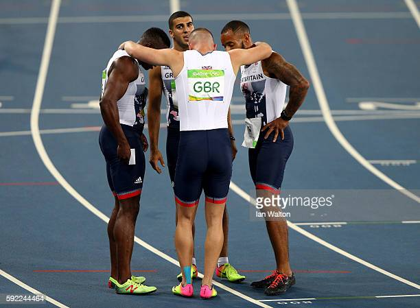Richard Kilty Harry AikinesAryeetey James Ellington and Adam Gemili of Great Britain react after the Men's 4 x 100m Relay Final on Day 14 of the Rio...