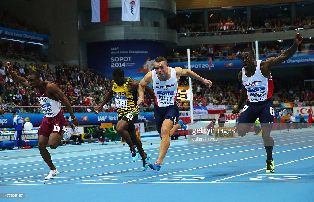 Richard Kilty of Great Britain wins the gold medal with team mate <a gi-track='captionPersonalityLinkClicked' href=/galleries/search?phrase=Dwain+Chambers&family=editorial&specificpeople=215102 ng-click='$event.stopPropagation()'>Dwain Chambers</a> (R), <a gi-track='captionPersonalityLinkClicked' href=/galleries/search?phrase=Femi+Ogunode+-+Sprinter&family=editorial&specificpeople=7355762 ng-click='$event.stopPropagation()'>Femi Ogunode</a> (L) of Qatar and <a gi-track='captionPersonalityLinkClicked' href=/galleries/search?phrase=Nesta+Carter+-+Sprinter&family=editorial&specificpeople=4335396 ng-click='$event.stopPropagation()'>Nesta Carter</a> of Jamaica in the Men's 60m Final during day two of the IAAF World Indoor Championships at Ergo Arena on March 8, 2014 in Sopot, Poland.