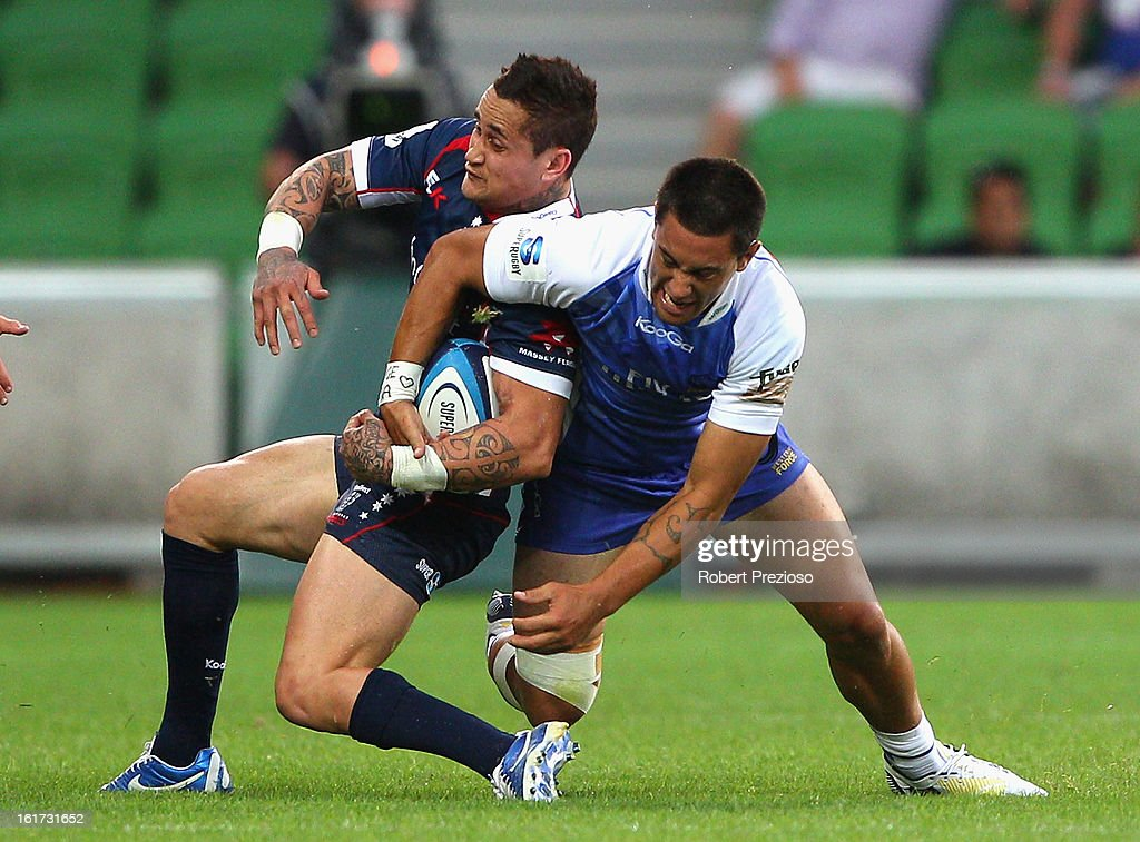 Richard Kingi of the Rebels is tackled by Sam Christie of the Force during the round one Super Rugby match between the Rebels and the Force at AAMI Park on February 15, 2013 in Melbourne, Australia.