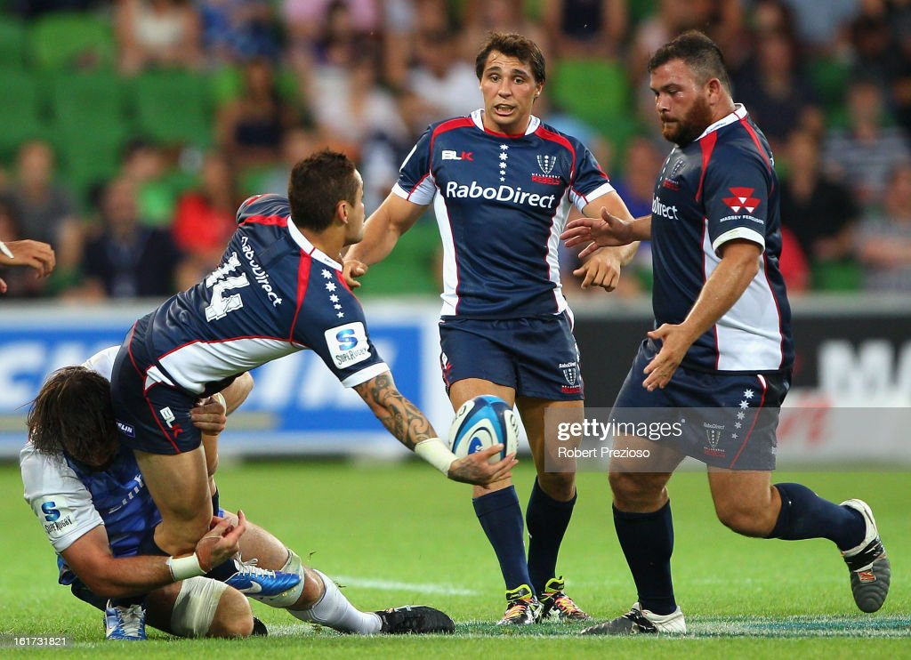 Richard Kingi of the Rebels offloads the ball during the round one Super Rugby match between the Rebels and the Force at AAMI Park on February 15, 2013 in Melbourne, Australia.