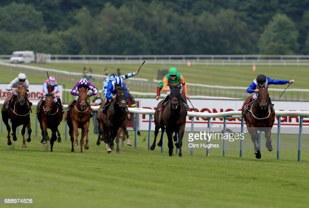 Richard Kingscote riding Rusumaat leads the field and wins the race during the Amix Silver Bowl Handicap Stakes at Haydock Racecourse on May 27 2017...
