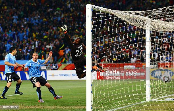 Richard Kingson of Ghana dives in vain as Diego Forlan of Uruguay scores his team's first goal from a free kick during the 2010 FIFA World Cup South...