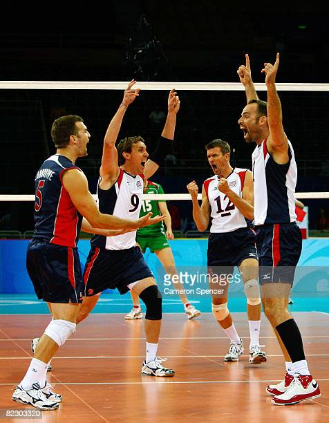 Richard Lambourne Ryan Millar and Thomas Hoff and Lloy Ball of the United States celebrate after defeating Bulgaria during the men's volleyball event...