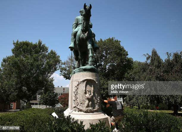 Richard Layne an Iraq and Afghanistan veteran pauses for a moment while touching the base of the Confederate Gen Robert E Lee statue that stands in...