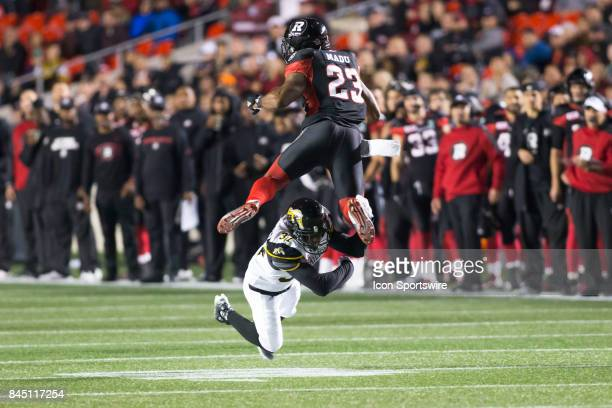 Richard Leonard of the Hamilton TigerCats lays big hit on Mossis Madu Jr of the Ottawa Redblacks to save the game by preventing a first down and...