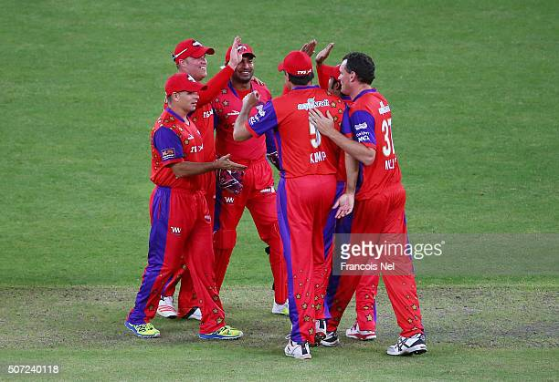 Richard Levi of Gemini Arabians celebrates with teammates after catching Jacques Kallis of Libra Legends during the opening match of the Oxigen...