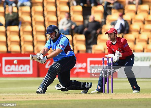 Richard Levi of Northants Steelbacks plays a shot as James Foster of Essex looks on during the Royal London OneDay Cup 2014 match between Northants...