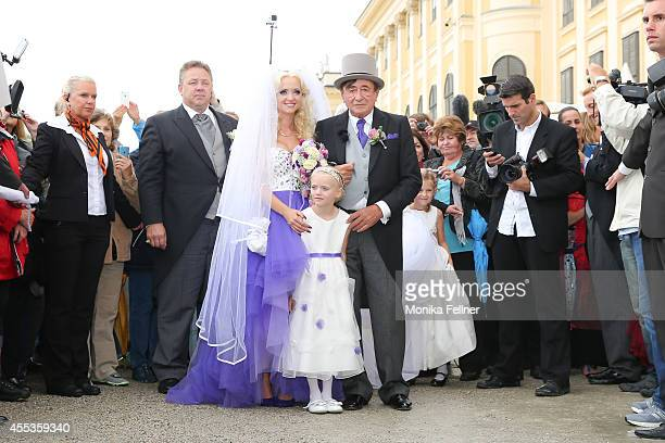 Richard Lugner and Cathy Schmitz after the get married with Caths daughter Leonie at Schoenbrunn Palace on September 13 2014 in Vienna Austria