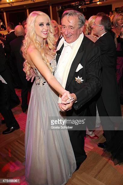 Richard Lugner and Cathy Schmitz attend the traditional Vienna Opera Ball at Vienna State Opera on February 27 2014 in Vienna Austria