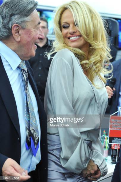 Richard Lugner and Pamela Anderson smile after their autograph signing at Lugner City on March 05 2012 in Vienna Austria