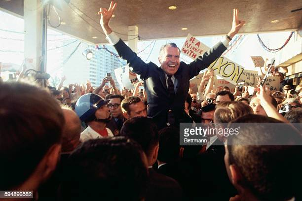 Richard M Nixon is mobbed by wildly cheering supporters as he arrives at the Hilton Plaza Hotel his Miami Beach headquarters