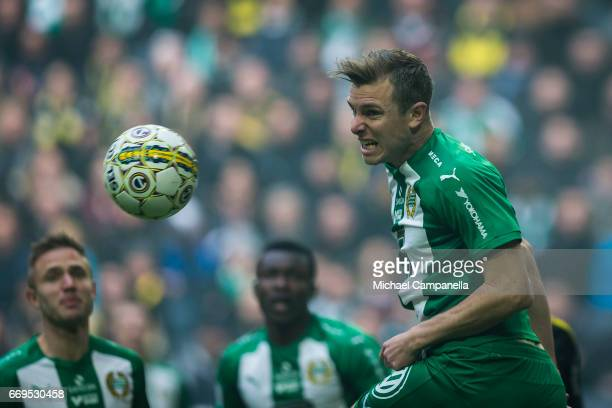 Richard Magyar of Hammarby IF clears the ball with a header during an Allsvenskan match between AIK and Hammarby IF at Friends arena on April 17 2017...
