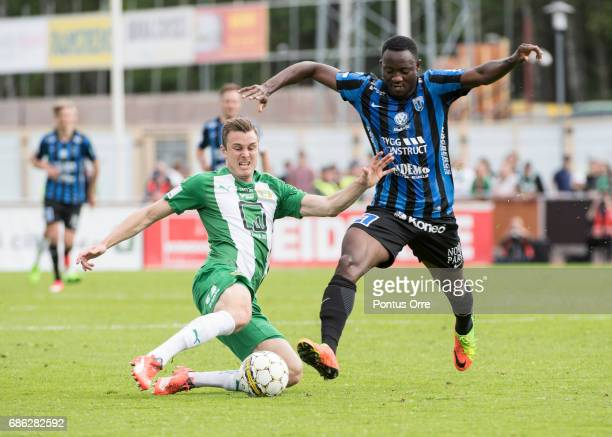 Richard Magyar of Hammarby IF makes a save against Moses Ogbu of IK Sirius FK during the Allsvenskan match between IK Sirius FK and Hammarby IF at...