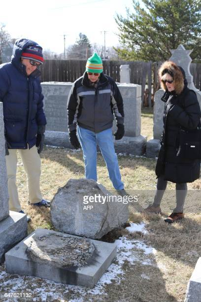 Richard Markus Sidney Markus and Sandy Rosenthal look at a vandalized gravestone at Stone Road or Waad Hakolel Cemetery in Rochester New York on...