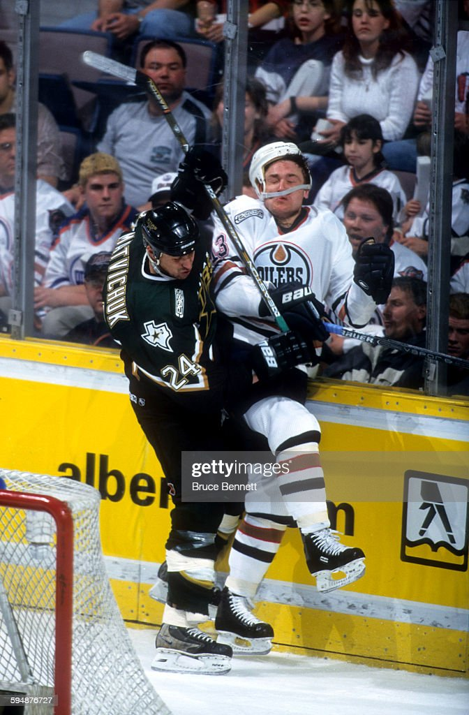 Richard Matvichuk of the Dallas Stars checks German Titov of the Edmonton Oilers into the boards during Game 3 of the 2000 Conference QuarterFinals...