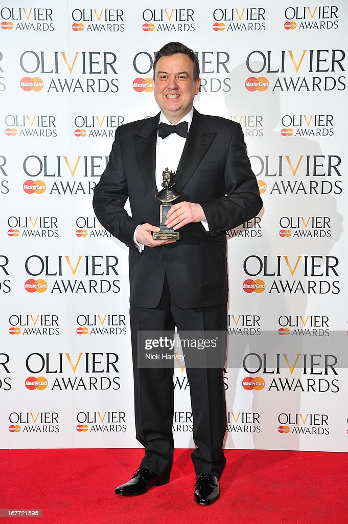 Richard Mccabe poses with his award The Laurence Olivier Awards at The Royal Opera House on April 28, 2013 in London, England.