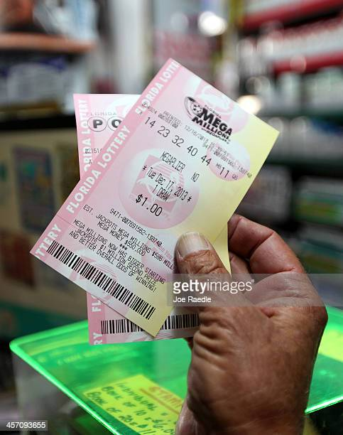 Richard Mcenery purchases Mega Million lottery tickets at Circle News Stand on December 16 2013 in Hollywood Florida The Mega Millions lottery...