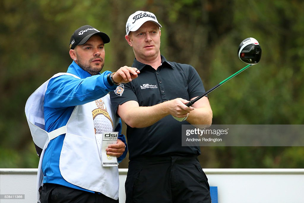 <a gi-track='captionPersonalityLinkClicked' href=/galleries/search?phrase=Richard+McEvoy&family=editorial&specificpeople=235337 ng-click='$event.stopPropagation()'>Richard McEvoy</a> of England speaks with his caddie before hitting his tee shot on the 11th during the first round of the Trophee Hassan II at Royal Golf Dar Es Salam on May 5, 2016 in Rabat, Morocco.