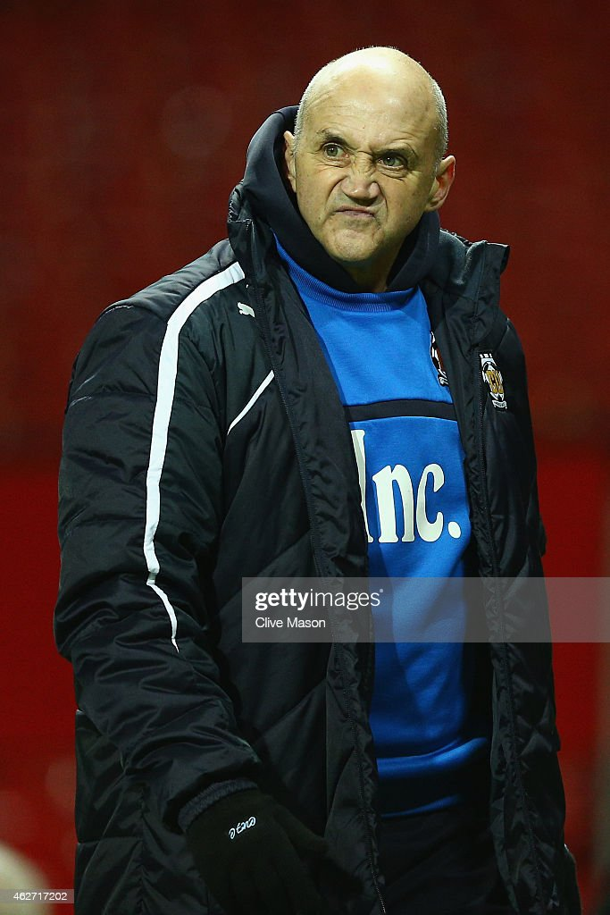 Richard Money, manager of Cambridge United looks on during the FA Cup Fourth round replay match between Manchester United and Cambridge United at Old Trafford on February 3, 2015 in Manchester, England.