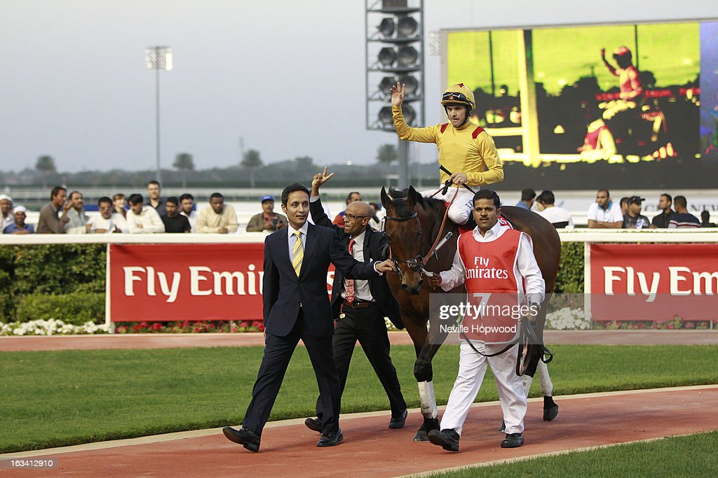 Richard Mullen on Reynaldothewizard after winning the 6f Group 3 Mahab Al Shimaal race being led in by assistant trainer Bhupat Singh during Super Saturday at Meydan Racecourse on March 9, 2013 in Dubai, United Arab Emirates.