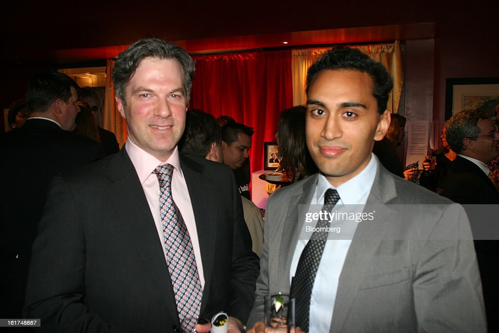 Richard Nash, head of government relations for Ebay Inc., and Usman Ahmed, the company's policy counsel attend a fundraiser for Tracy's Kids at Lucky Strike in Washington D.C., U.S., on Wednesday, Feb. 13, 2013. The event raised money for a cancer charity. Photographer: Stephanie Green/Bloomberg via Getty Images
